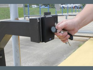 image of hand unlocking gate with rf key fob